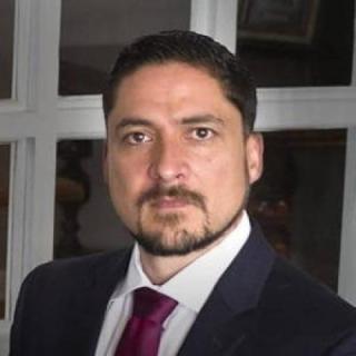 Joseph E Munoz